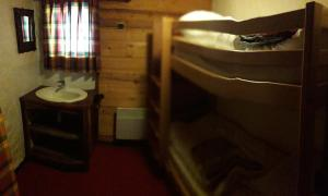 A bunk bed or bunk beds in a room at Namasté chalet hostel