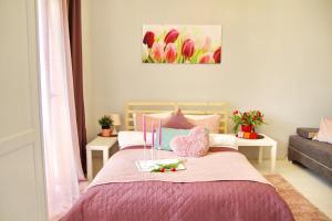 Posteľ alebo postele v izbe v ubytovaní Tulip Apartments City Centre