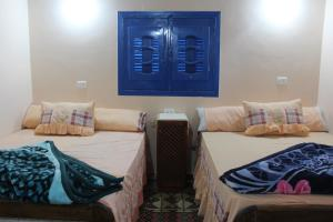 A bed or beds in a room at Tunis Village Chalet