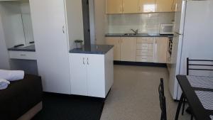 A kitchen or kitchenette at AZA Motel