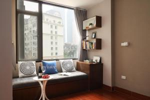 A seating area at ISTAY Hotel Apartment 1