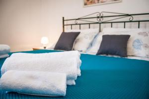 A bed or beds in a room at Case Vacanza Torre Canne