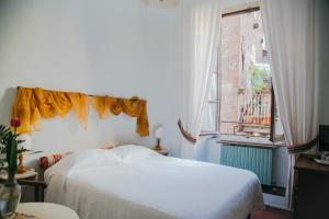 A bed or beds in a room at B&B La Romea