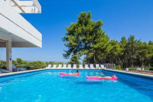 The swimming pool at or near Adriatiq Hotel Hvar - All Inclusive