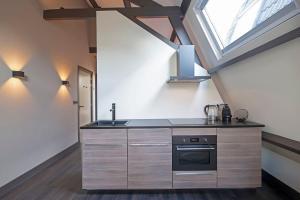 Een keuken of kitchenette bij Loft Studio's