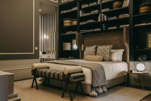 A bed or beds in a room at Torel 1884 Suites & Apartments