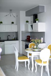 Kuchnia lub aneks kuchenny w obiekcie SŁONECZNA MORENA