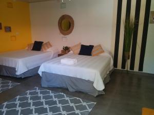 מיטה או מיטות בחדר ב-Izus Place Complex