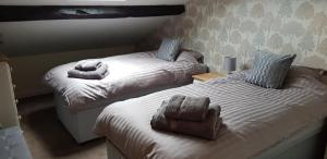 A bed or beds in a room at 10 Chad Valley