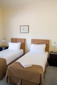 A bed or beds in a room at Tranquil Vale Vineyard