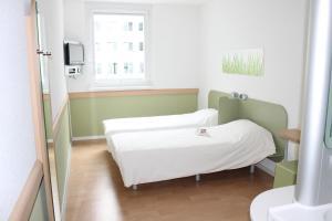 Cama o camas de una habitación en Ibis budget Wien Messe