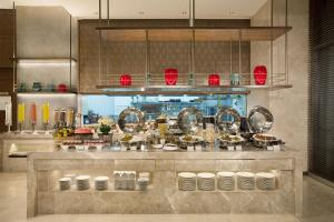 A kitchen or kitchenette at Ascott Sudirman Jakarta