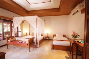 En eller flere senge i et værelse på Bhundhari Chaweng Beach Resort Koh Samui