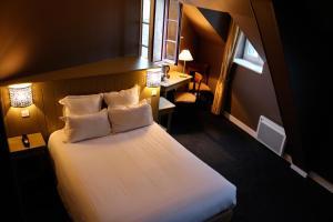 Ein Bett oder Betten in einem Zimmer der Unterkunft La Mère Poulard