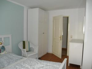 A bed or beds in a room at Appartement Cécile