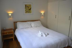 A bed or beds in a room at Bundalong Waterfront- 28 Graham Ave, Bundalong