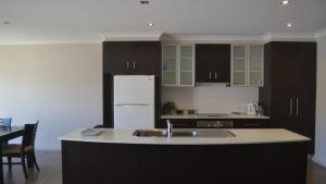 A kitchen or kitchenette at 33B Cypress Drive Mulwala