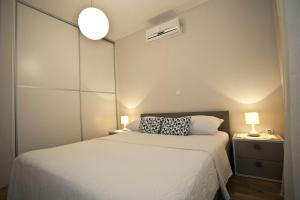 A bed or beds in a room at Apartments Cvita