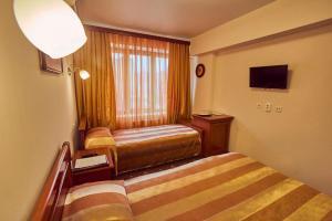 Кровать или кровати в номере Le Vashoff Отель