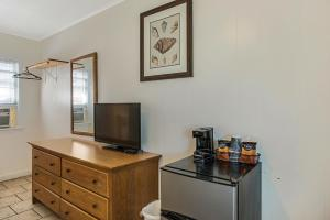 A television and/or entertainment center at Dolphin Oceanfront Motel - Nags Head