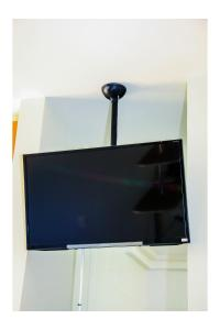 A television and/or entertainment centre at Flats Service Bueno