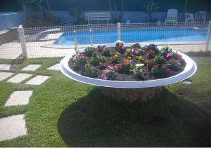 The swimming pool at or near Casa Teresinha