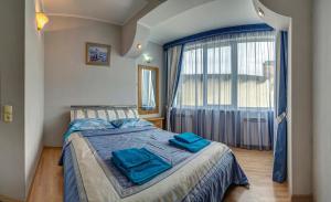 Кровать или кровати в номере Klimenko House