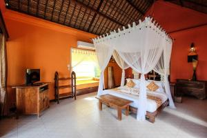 A bed or beds in a room at Amertha Bali Villas