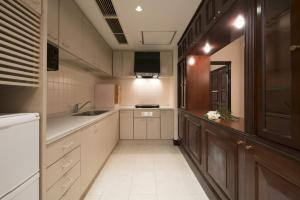 A kitchen or kitchenette at Hotel Alps (Adult Only)