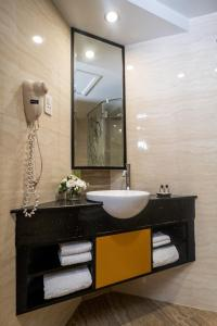 A bathroom at Sanouva Saigon Hotel