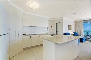 A kitchen or kitchenette at Majorca Isle Beachside Resort