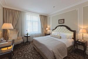 Кровать или кровати в номере Эрмитаж - официальная гостиница государственного музея