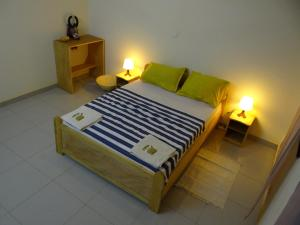 A bed or beds in a room at Villa Asha