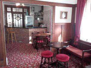 The lounge or bar area at Clumber House Hotel