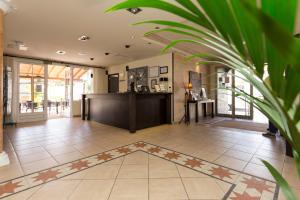 El vestíbulo o zona de recepción de La Aldea Suites