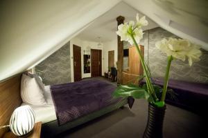 Łóżko lub łóżka w pokoju w obiekcie Gościniec Nad Gopłem