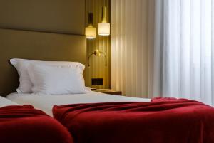 Кровать или кровати в номере Hotel Regina