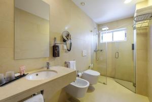 Ванная комната в Hotel Regina