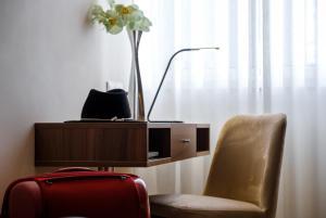 Телевизор и/или развлекательный центр в Hotel Regina