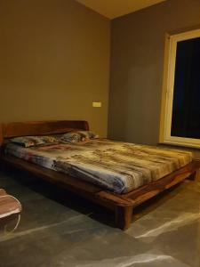 A bed or beds in a room at The Rooftop Cabana, A Homestay