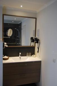 Ein Badezimmer in der Unterkunft Hotel Rubens