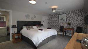 A bed or beds in a room at Number 1 Kildale