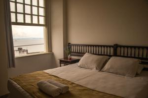 A bed or beds in a room at OYO Hotel Pelourinho