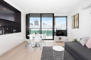 A seating area at South Yarra City View Apartment with Car Park, Amazon Alexa, Spotify, Netflix, and WiFi