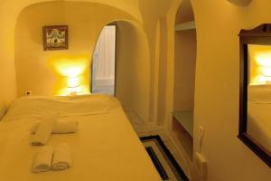 A bed or beds in a room at Zoe Aegeas