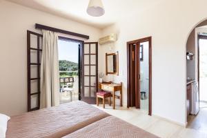 Ein Bett oder Betten in einem Zimmer der Unterkunft Santa Maria Studios & Apartments