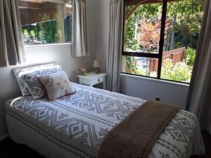 Säng eller sängar i ett rum på Rangaroa Heights