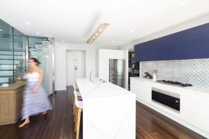 A kitchen or kitchenette at CC by the Sea