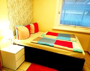 A bed or beds in a room at City Apartment East Side