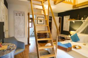 A bunk bed or bunk beds in a room at Lodge Seaside Boutique Hotel